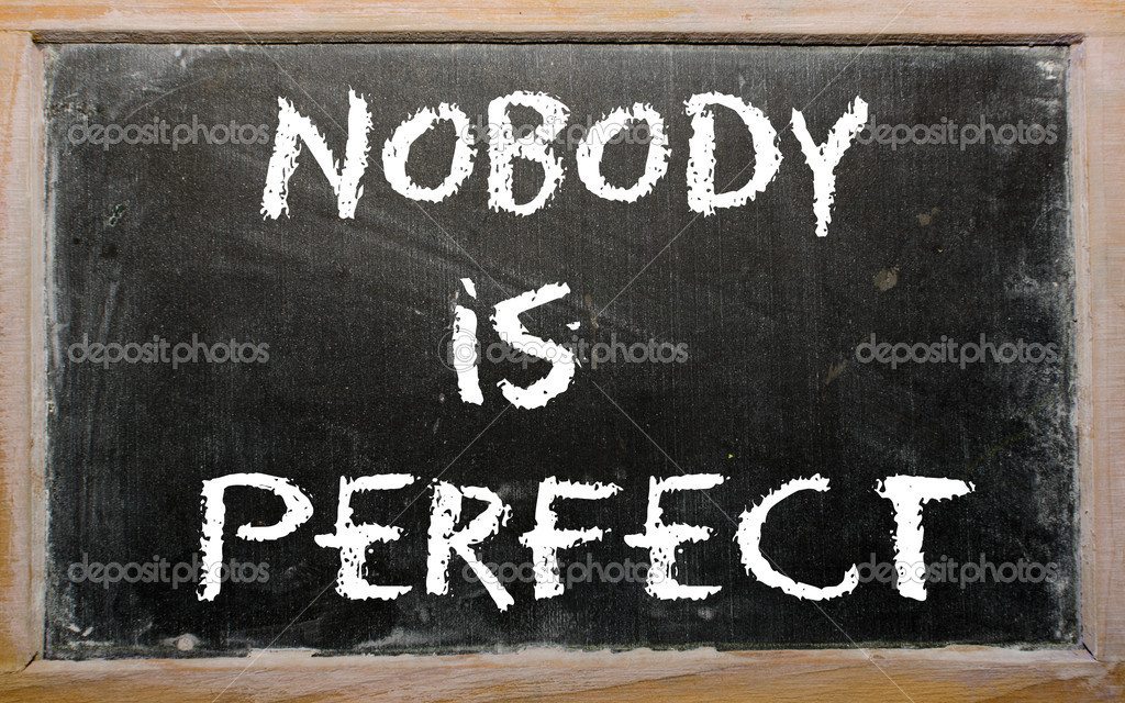 "Proverb ""Nobody is perfect"" written on a blackboard"